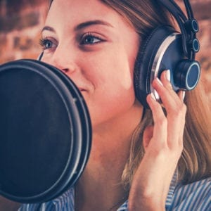 Woman creating a voiceover for videos